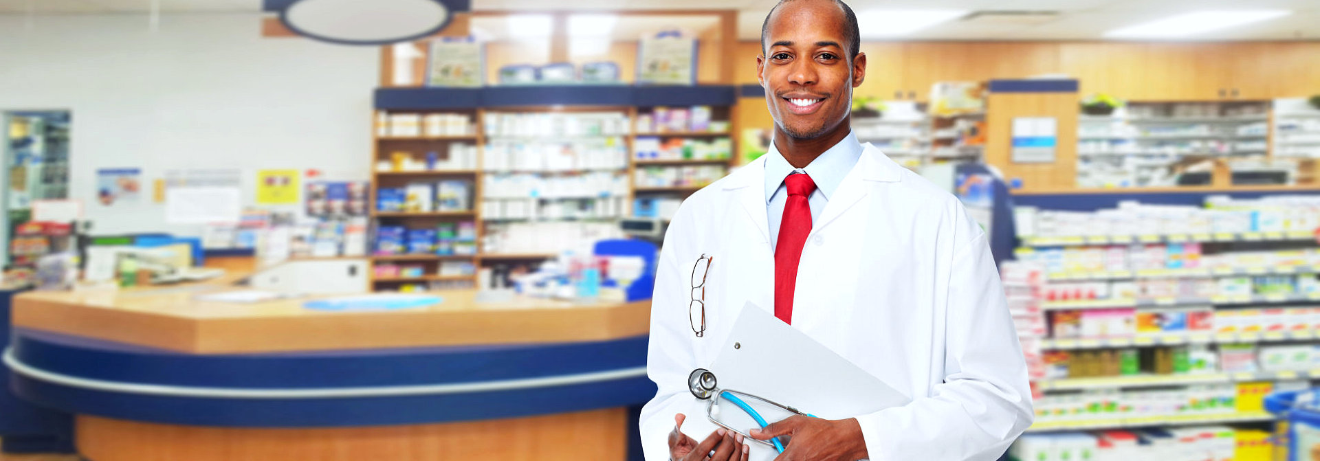 male pharmacist holding his clipboard and stethoscope