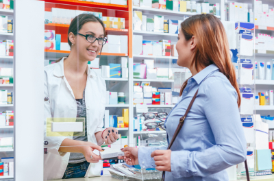 pharmacist talking with a customer at the pharmacy desk
