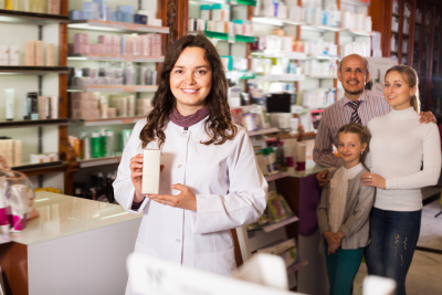 woman pharmacist standing with a desk in the pharmacy